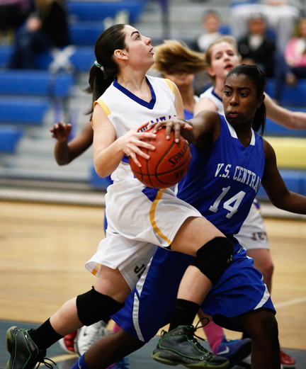 East Meadow's Gabby Heim, left, drives against Valley Stream Central's Kendall Jones during last Monday's Conference AA-II game.