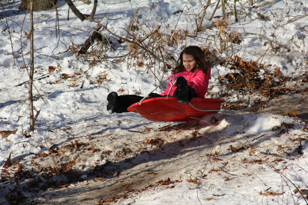 Rebecca Depaoli got some air after sledding over a hill some children built.