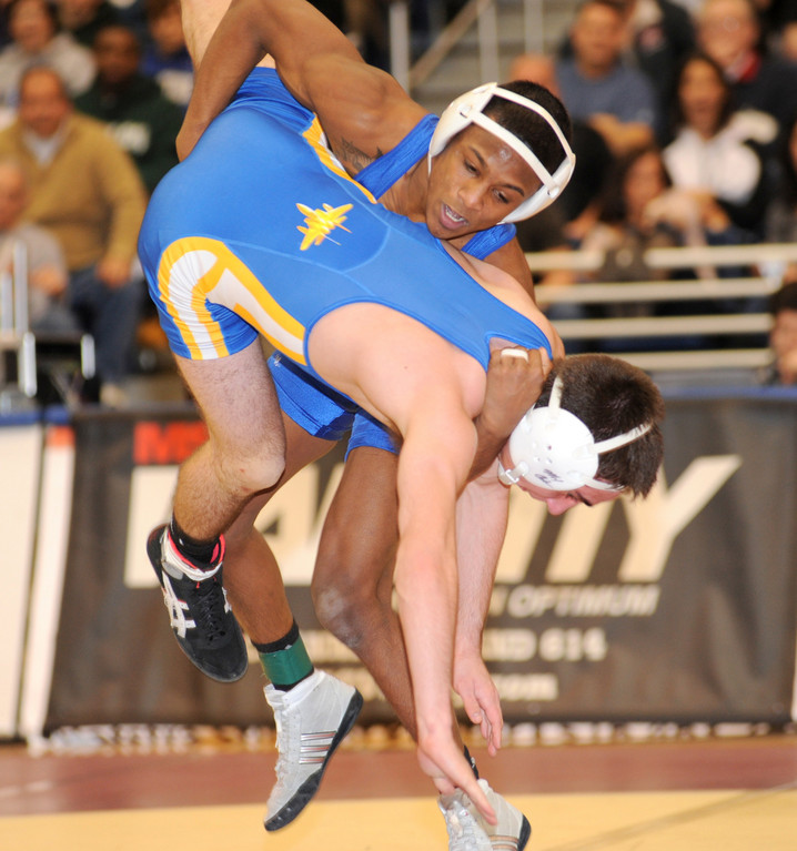 Long Beach's Steven Sewkumar pulled out a 6-5 win over East Meadow's Adam Smith in the 113-pound county title bout on Feb. 12 at Hofstra.
