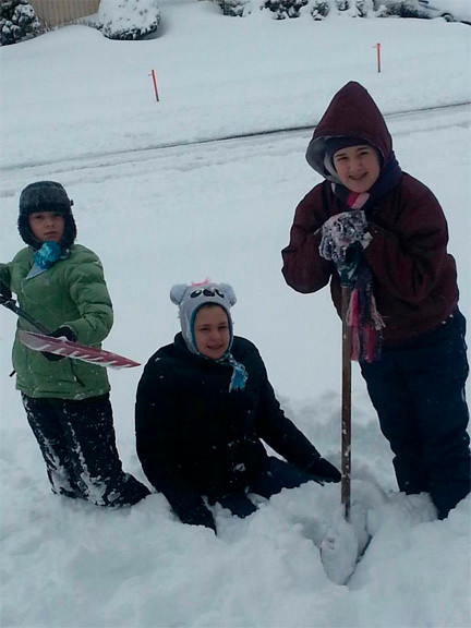 Nicole, Julianne and Danielle Hallett, of Murray Drive in Westbury, helped shovel snow following the storm.