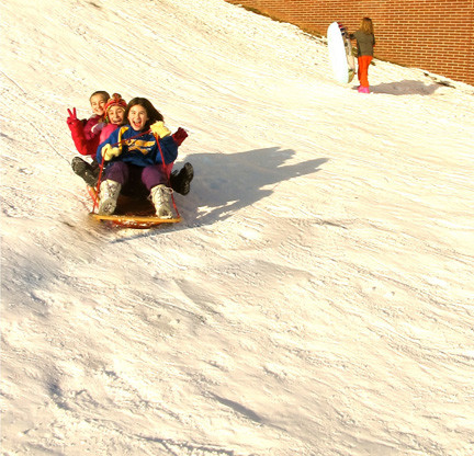Janet Xhindolli and Alexa and Arianna Duhs enjoyed some sledding outside of Barnum Woods Elementary School.