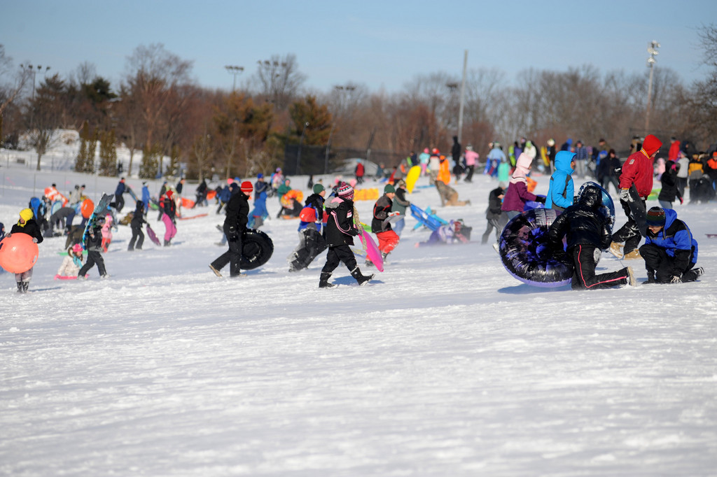 Hundreds of residents stampeded through the snow at Eisenhower Park on Saturday.
