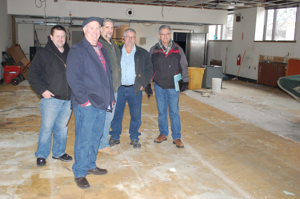 the first floor of 195 Rockaway Ave. will eventually become Valley Stream's new courtroom. From left are village Safety Officer William Grace, Building Superintendent Tom McAleer, carpenter Jimmy Neal, electrician Brian Howley and building manager John Mastromarino.