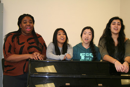 Hewlett High School juniors, from left, Laurie Antoine, Rose Generoso, Jasmine Pei and Maria Suleymanov, have been singing together since eighth grade.