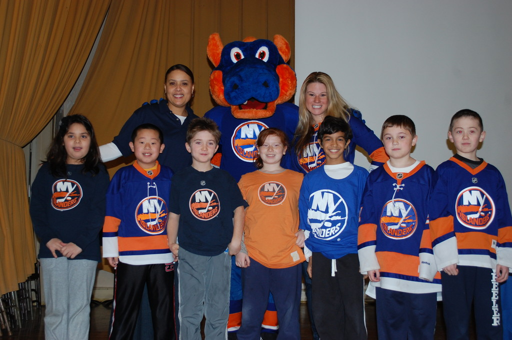Many Students at Wheeler Avenue School came dressed in their Islanders gear to meet Sparky the Dragon and Dina Tsiorvas, the arena hostess, on Feb. 1.