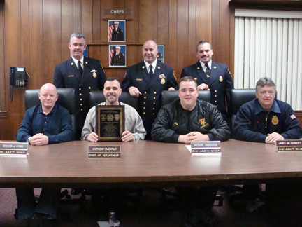 Lynbrook fire chiefs accepted a heartfelt thank you from the East Rockaway Fire Department. Pictured seated were, from left, 1st Assistant Chief Ed Hynes, Chief of Department Anthony DeCarlo, 2nd Assistand Chief Michael Anderson, and  3rd Assistant Chief James McDermott. Standing were East Rockaway Fire Department chiefs, from left, 2nd Assistant Chief James Henshaw, Chief of Department Steve Torborg, and 3rd Assistant Chief Tom Johnson.