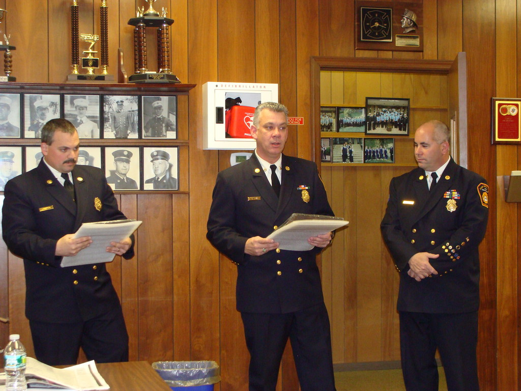 Chiefs Tom Johnson, left, James Henshaw and Steve Torborg presented each of the Lynbrook Fire departments with awards.