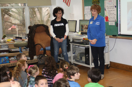 North Shore Animal League representatives Jayne Vitale, left, and Lauraine Merlini spoke to students at Lynbrook�s Waverly Park School about the plight of homeless pets in the wake of Superstorm Sandy.