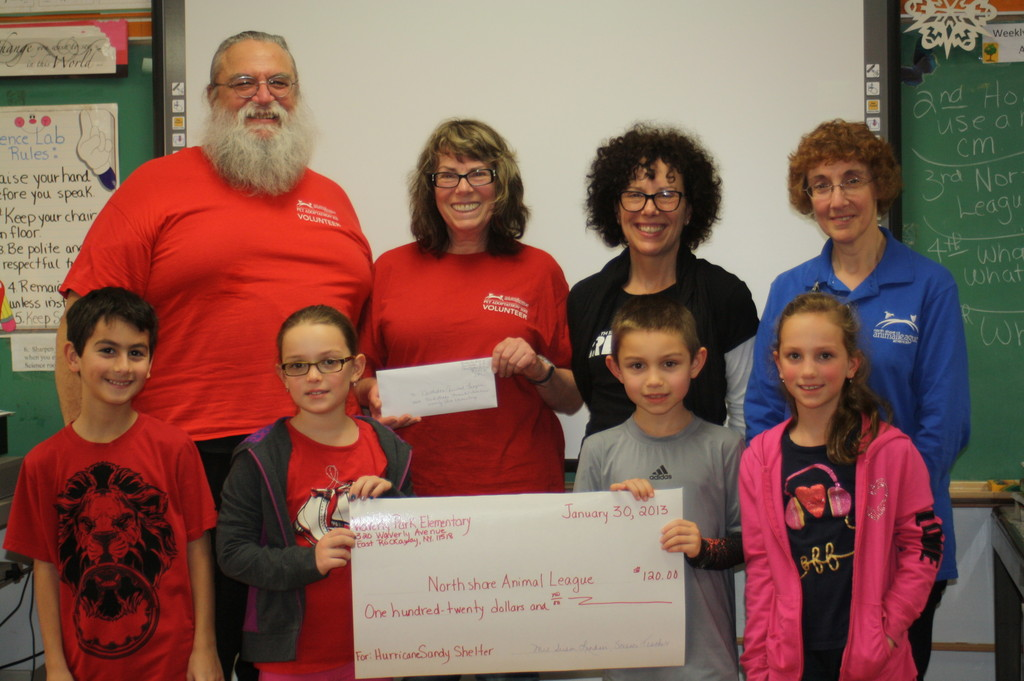 The third-graders presented a check for $120 to representatives from NSALA to show their support of the hurricane relief shelter. In front were Waverly Park students Jordan Abate,left, Katherine Tuosto, Aidan Blank and Natalie Tuosto. In rear were NSALA  representatives Ben and Marian Savio, Jayne Vitale and Lauraine Merlini.