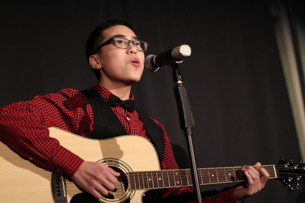 Freshman Jonathan Cuevas sang and played the guitar during �I�ve Got This Friend,� which was a duet with Elaine Chen.
