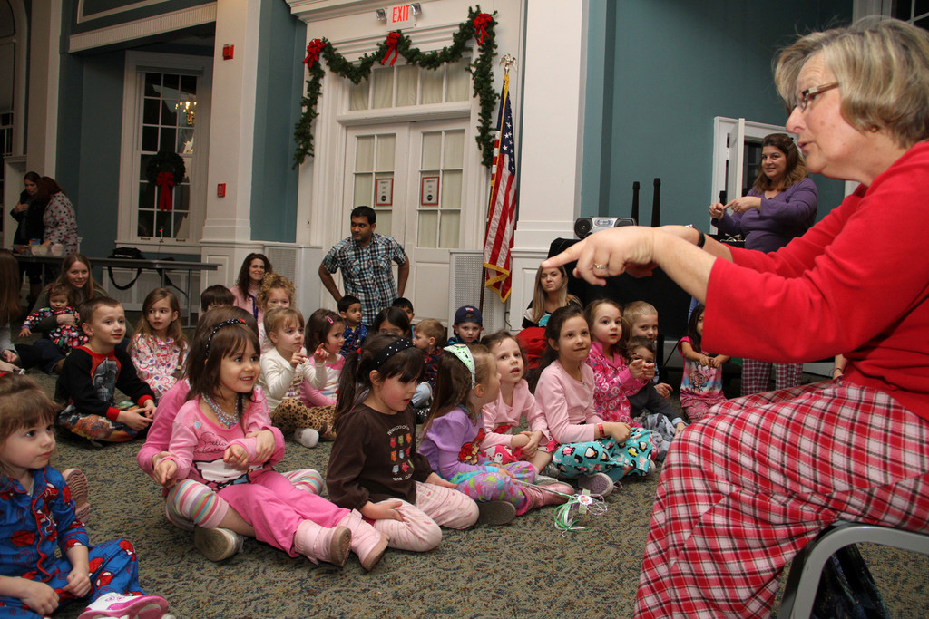 Miss Rita Baker of Intercommunity Nursery School led the children in song during pajama time at the library.