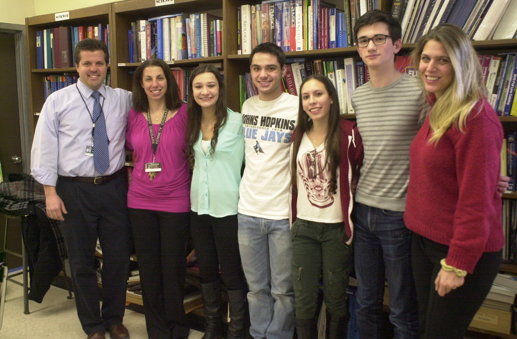Five Kennedy High School seniors were recently awarded Intel research badges. Four of the honorees, center, from left, were Natalie Giovino, Joshua Pollock, Sara Rosenzweig and David Barsky. Joining them were their research advisers, at left, Helmut Schleith and Barbara Franklin, and right, Barbie Frank.