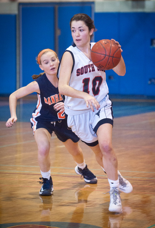 South Side's Juliana Pellegrini, right, who scored a game-high 14 points, had a step on Manhasset's Erin Barry during last Saturday's first-round playoff matchup.