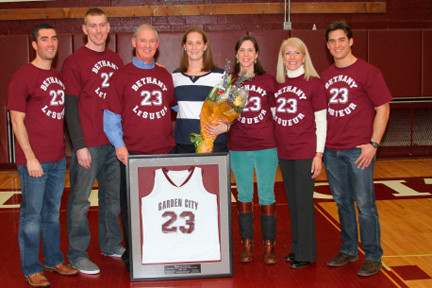East Meadow High School girls' basketball coach Bethany LeSueur, center, recently had her jersey retired at her alma mater, Garden City High School. She is pictured, from left to right, with her brother Paul Jr., husband Tom Hughes, father Paul, sister Sarah, mother Liz and twin brother Peter.