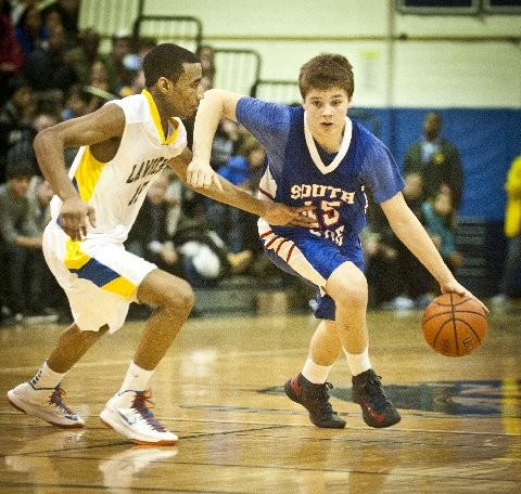 South Side's Alex Sorensen, right, works around Lawrence's Clifton Lyerly.