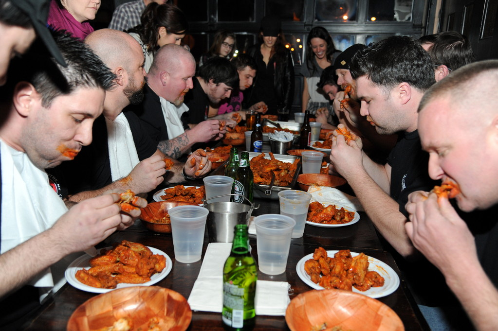 Participants wasted no time biting into their wings.
