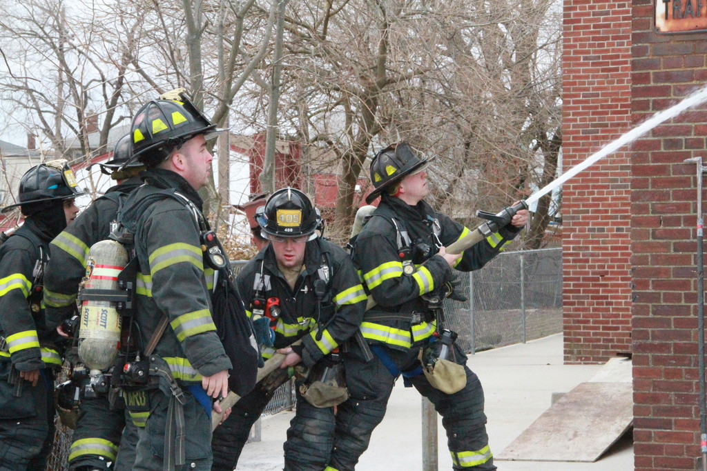 East Rockaway firefighters extinguish a small fire at the high school. No students were attending.
