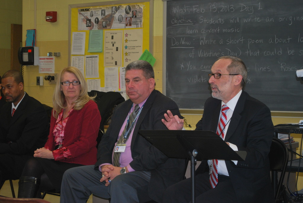Lawrence school district officials held a town hall meeting to discuss the relocation plan and the Number Six School. From left were middle school Principal Willis Perry, Assistant Superintendents Dr. Ann Pedersen and Pat Pizzarelli and Superintendent Gary Schall.