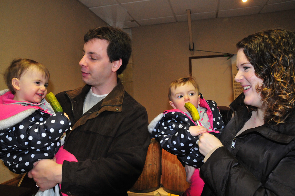 Mitchell and Lauren Ribera gave twins Julia and Natalie, 1, a taste of sour pickles at the first Baldwin winter farmers market. The market will convene every Saturday until late April and perhaps after that as well.