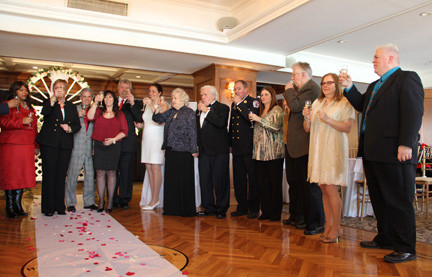 The couples gathered with Supervisor Kate Murray for a champagne toast following the ceremonies.