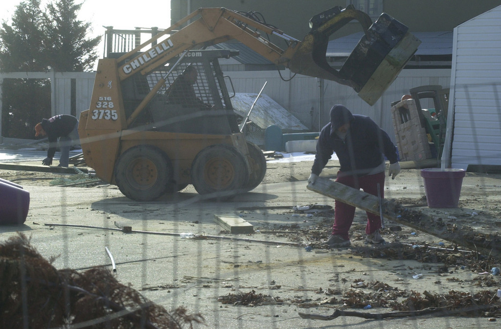 A cleanup crew removed debris from the Merrick Estates Civic Association and Pool Club last week, 3 1/2 months after Hurricane Sandy caused an estimated $250,000 in damage to the facility.