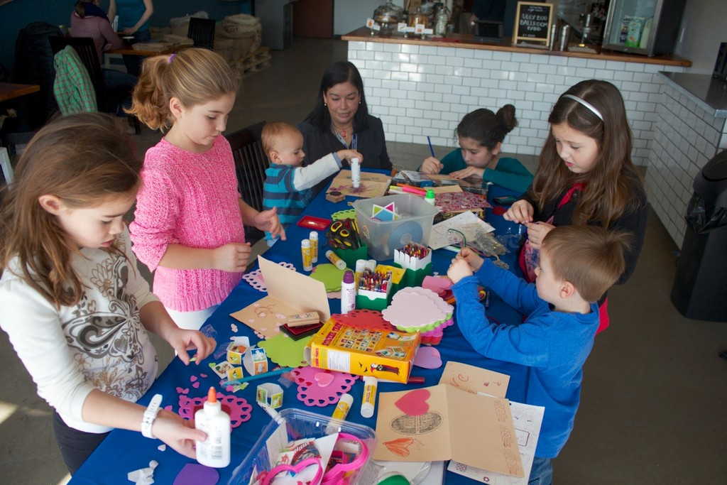 Project Hope volunteers are on hand to help at a children's art forum at Gentle Brew Cafe