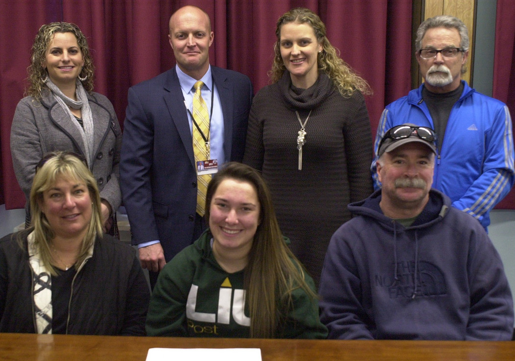 Mepham senior Nicole Stackpole will play lacrosse for C.W. Post. She is pictured here with her parents, front row, Naomi and Michael, and, back row, from left, Carne, Harrington, Mepham lacrosse coach Geraldine O'Brien and Muscara.