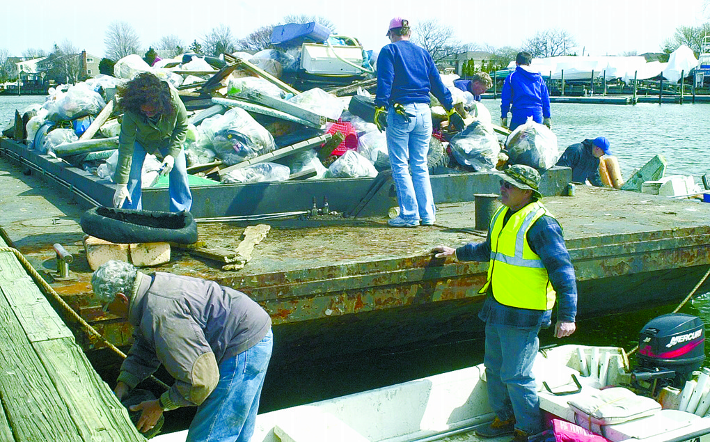 Operation SPLASH, a Freeport-based nonprofit environmental group, has scheduled its annual Op-SPLASH cleanup for March 16, in Freeport. At last year's cleanup in East Rockaway, above, volunteers loaded trash onto a barge.
