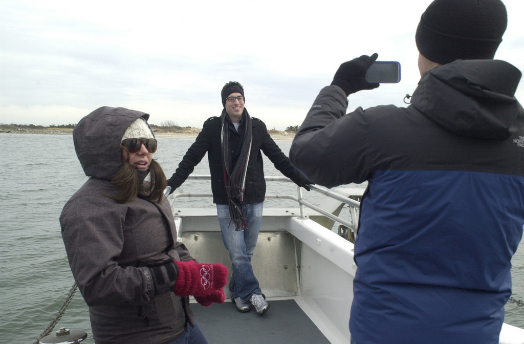 Merrick Herald reporter Brian Racow, front, took a shot of East Meadow Herald Editor David Weingrad at the bow of the Capt. Lou VII, with Long Beach reporter Alexandra Spychalsky at left.