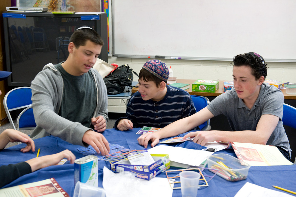 SULAM-LI's mission is to teach Jewish children with special needs about their religious and cultural heritage. From left volunteer Harper Berman, student Shimon Sassoon and volunteer Matthew Goldstein played a card game.