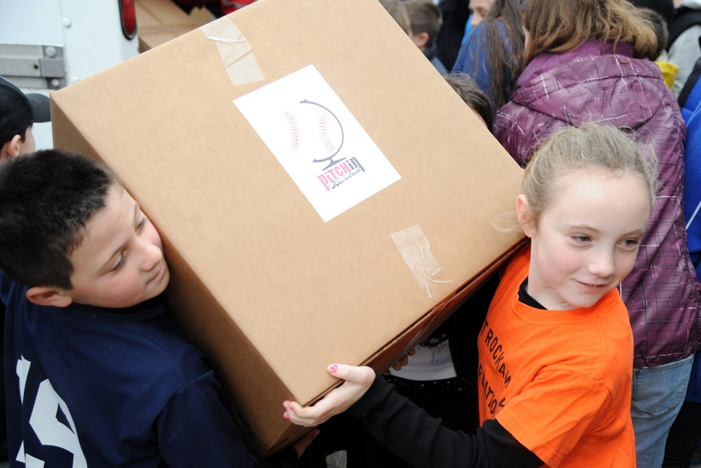 Two little leaguers carried a box bigger than them!
