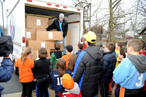 Everyone pitches in to help unload the truck.