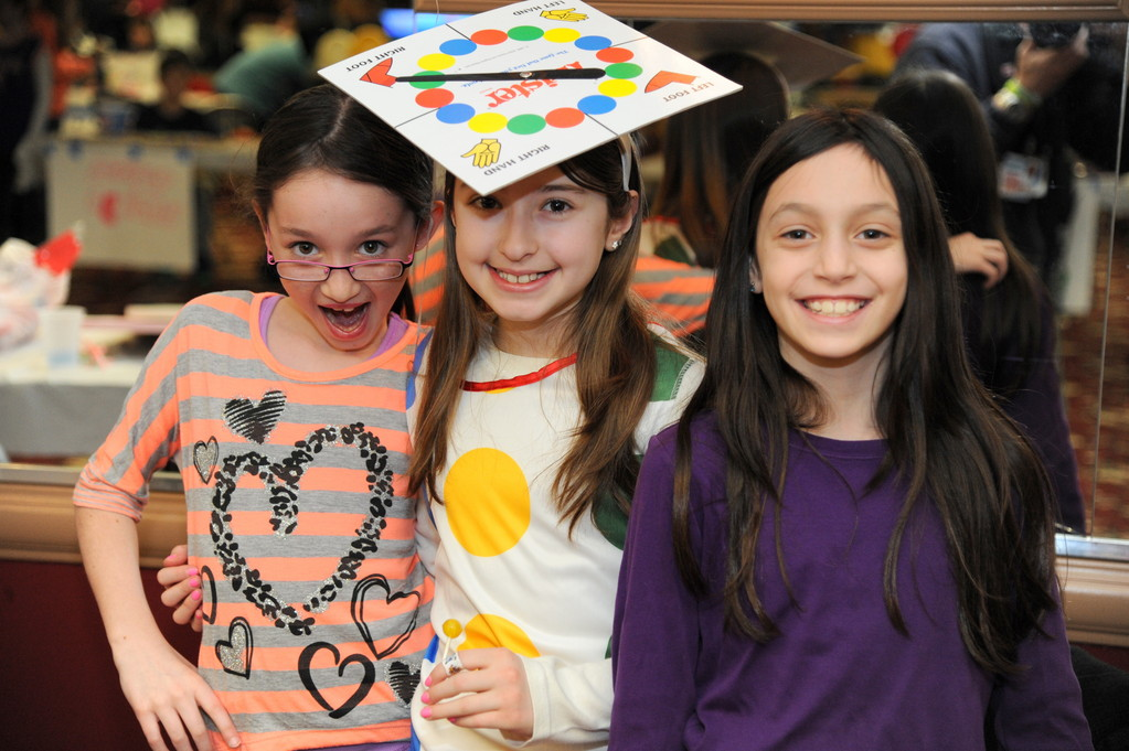 Children from Temple Hillel's youth group and religious school hosted a Purim carnival on Feb. 24 at the North Woodmere synagogue. From left Lexi Michael,11,Brooke Bergin, 11, and Remi Liebowitz, 10, took part in the fun.