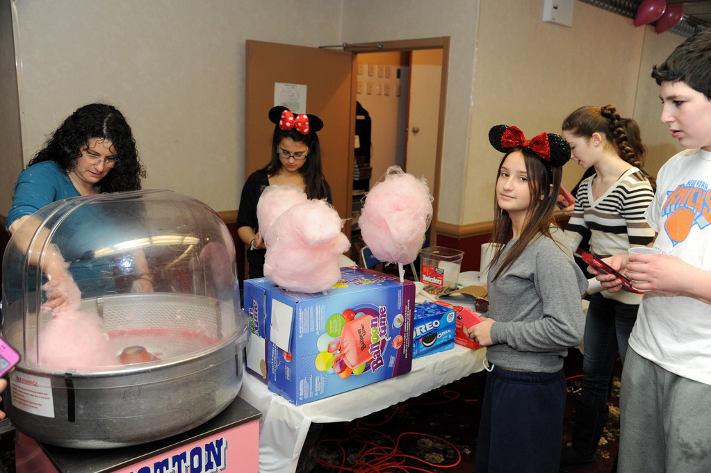 Cotton Candy satisfied the sweet tooth of many of the kids' during the Purim celebration at Temple Hillel.