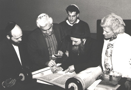 Congregation Ohav Sholom is celebrating its 50th anniversary in 2013 with a series of celebrations. Above, a torah dedication at Ohav Sholom's 25th anniversary in 1987.