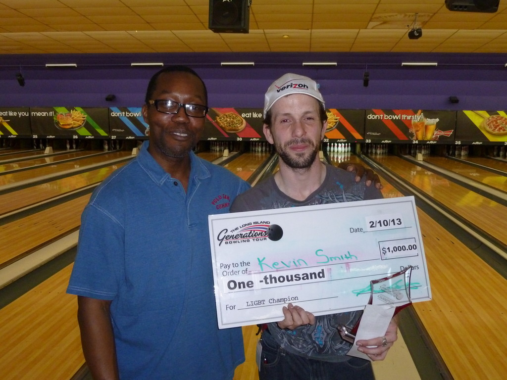 Kevin Smith, right, defeated Hicksville resident Darcy Monroe, left, 263 to 249 and won the grand prize of $1,000 at the Long Island Generations Bowling Tour in Plainview on Feb. 10.