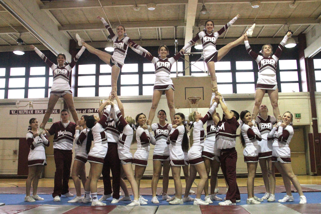 With an arsenal of new stunts, the Mepham High School varsity cheerleading team 