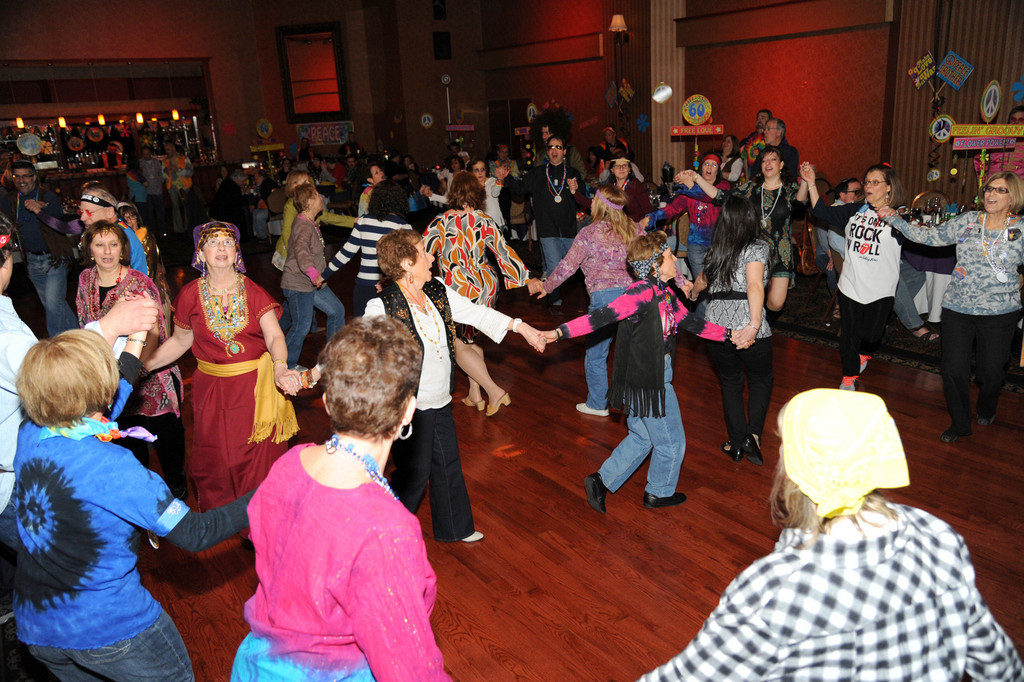 Dozens donned retro attire while celebrating both Purim and the synagogue's 60th anniversary.