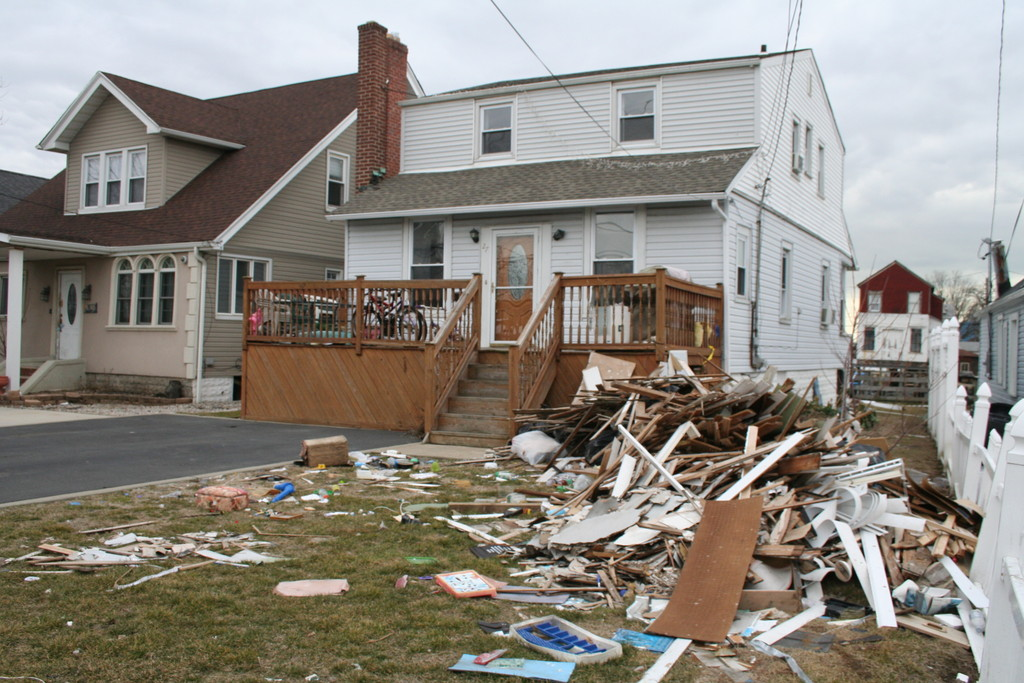 Debris litters the property at 27 East Ave. in Meadowmere Park, where residents are still struggling more than four months after the hurricane.