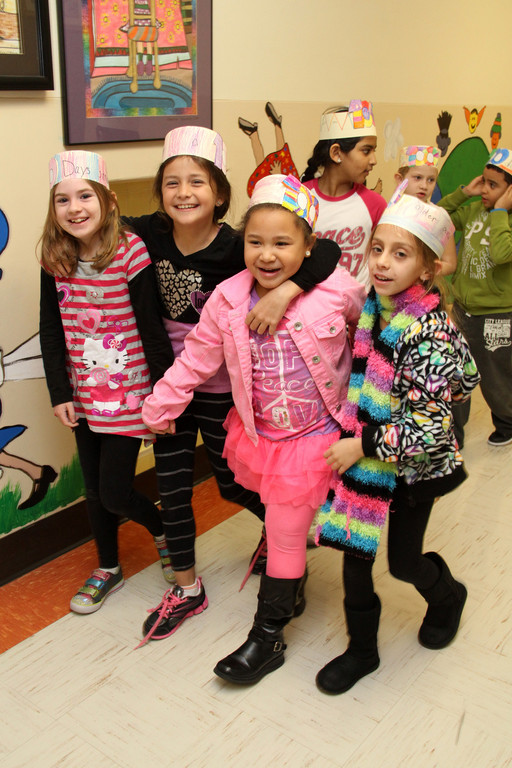 Second graders Caitlin Flanagan, Sarah Rizzo, Olivia Bonhomme and Jade Hornick proudly marched down the hall in the Carbonaro School's annual 100th day parade.