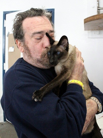 Long Beach resident Randy Lerner and his companion, Max, made it through the storm together.