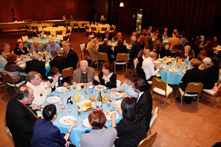 The attendees enjoy a wonderful dinner before the service.