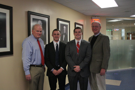 Scholarship winners Gareth Moore, second from left, and Patrick Lisante were congratulated on their win by Associate Dean Ron Carman, left, and Dean Stephen Bier.