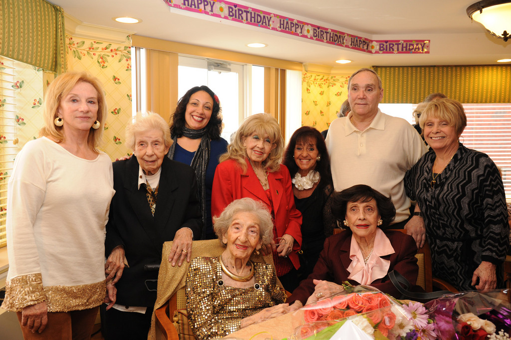 Frances Silece Reder, celebrated her 100th birthday on Feb. 27 at Bristal Assisted Living in Westbury. Seated next to her sister, Dolores Storch, she was also joined by, from left, daughter Anne Jensen, sister Rose Reder, niece Marie Whitman, sister Regina Riccardi, daughter Rosemary, nephew Jimmy DeCarluccio and niece Connie DeCarluccio.