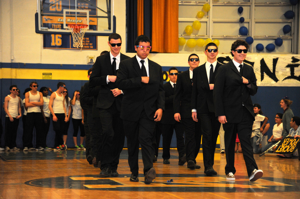 "The ""Men in Black,"" or the East Meadow seniors, represented the '90s during the school's time period-themed Battle of the Classes."