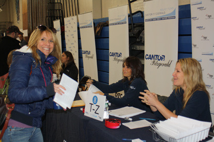 Parent Rachel Wachs was among more than 1,000 families that lined up at Long Beach Middle School on March 1 to receive $1,000 gift cards from the Cantor Fitzgerald Relief Fund. Five Long Beach schools are among 19 in the tri-state area that are receiving aid from Cantor Fitzgerald in the wake of Hurricane Sandy.