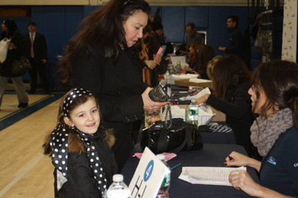 Blackheath Pre-K student Izzy Lapi waited as her mother, Linda, received a $1,000 gift card.