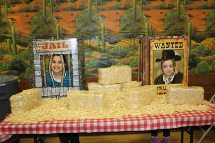 "IsabelLa Magliaro, 10, and gaby esposito, 9, had fun taking pictures as cardboard characters at Polk Street School's ""Wild West Bingo"" night on March 9."