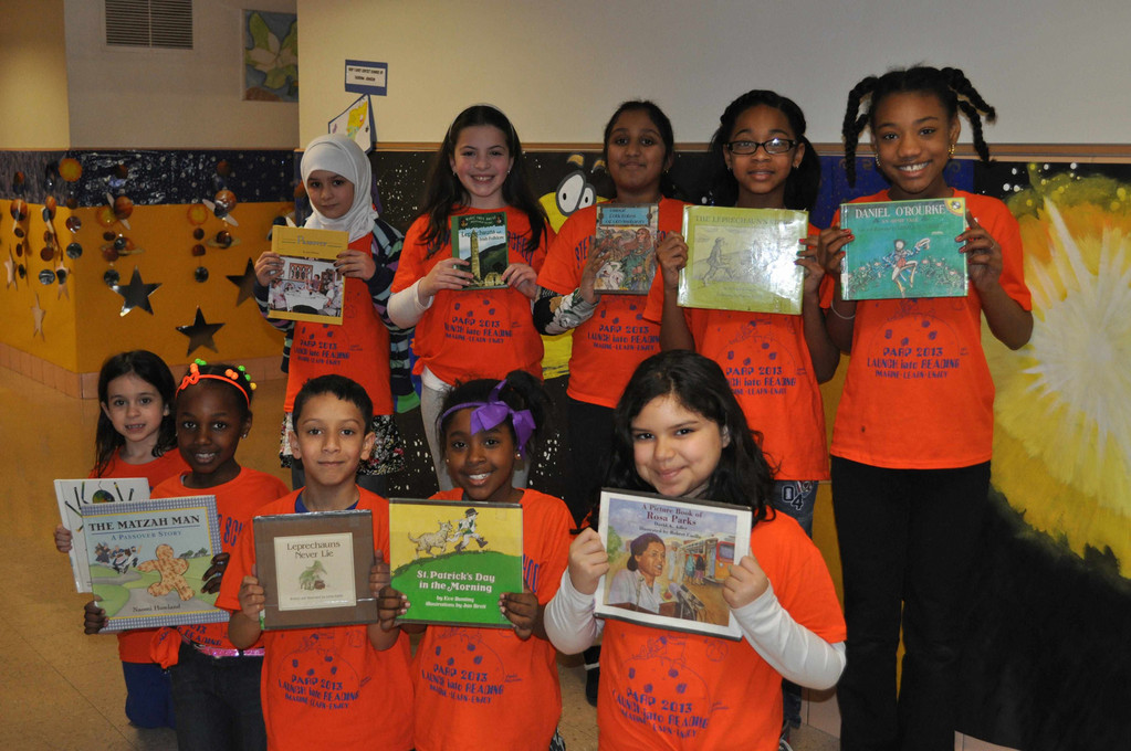 Students from Stewart Manor School hold up books in honor of this year�s space-themed PARP.