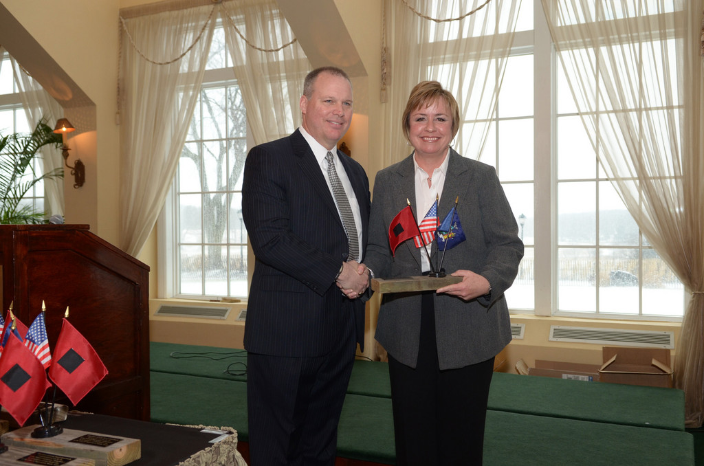 Town Supervisor Kate Murray receives an award of recognition from LICA.